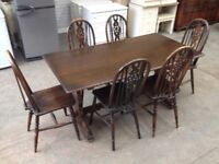 OLD CHARM SOLID OAK DINING TABLE & 6 WHEEL BACK CHAIRS ~~ CAN DELIVER TO WEST MIDLANDS