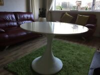 White high gloss round table very modern with unusual base from smoke free house