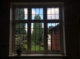 Large oak leaded window