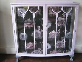 Vintage/retro china/display cabinet in pink with pink/black floral back