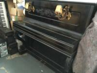 Old ebony and ivory upright piano