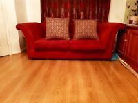 Two Red Sofas with cushions