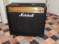 Marshall MG 100 dfx amp with foot switch, soft vinyl cover and 4 locking wheels.