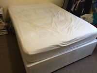 A double divan bed with mattress in excellent condition, only 10 months old