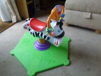 Fisher-Price 'Bounce & Spin' Horse , stationary musical ride -on-toy in v.g.c
