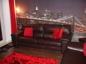 2 brown leather 3 seater sofas, excellent condition £300