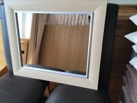 Wood and silver trimmed mirror