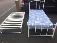 Single metal bed with trundle