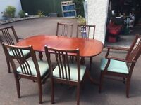 Mahogany table with 2 carver and 4 plain chairs