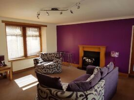 Ground floor flat with off street parking and private garden