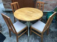 Dining table and 4 chairs. Can deliver