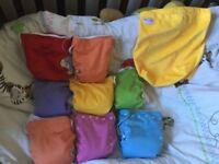 8 used Wonderoo v3 reusable nappies with bag