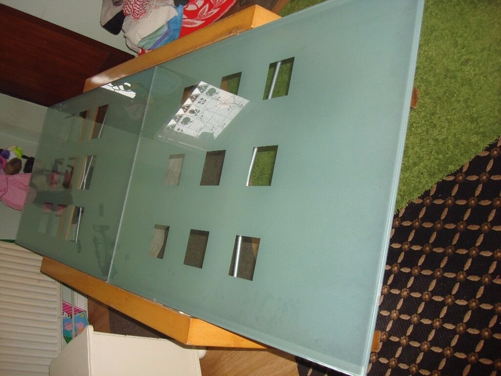 for sale extendable dining table glass and wood frame good condition ready to goin Bradford, West YorkshireGumtree - for sale extendable dining table glass and wood frame very good condition lenght 1,40cm,width 95cm,height 74cm for more info and view please call thanks