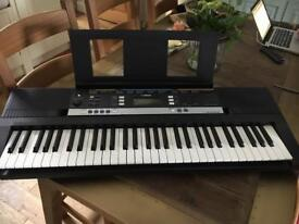 Yamaha electric portable keyboard with stand.