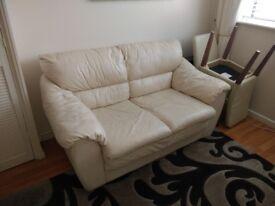 Cream two seater leather sofa