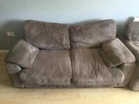 Two two seater brown cord sofas