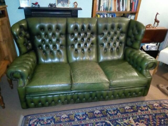 Olive green, leather, high-back Chesterfield sofa. | in ...