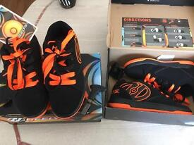 Child's heelys new never been worn size 2 and 4