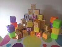 Wooden alphabet blocks and shape sorters