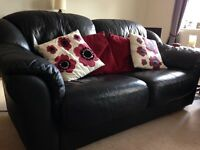 Black leather sofas - 2 seater and 3 seater both in excellent condition.