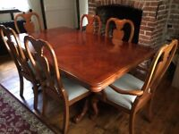 Walnut dining table, four chairs and two carvers plus two extendable leaves