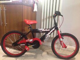 "18"" boys Huffy Rebel bike, great condition."