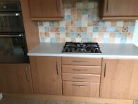 Kitchen units including double oven and hob