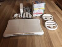 Nintendo WII with WII fit board and 15 games