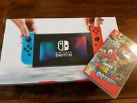 Brand new Nintendo Switch with Mario Odessey