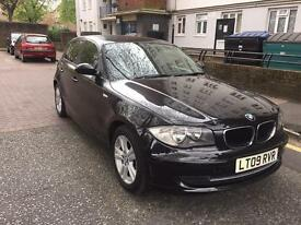Black BMW 1 series 116 i 1.6L 5 door