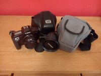 Canon EOS SLR with additional Tamron Lens
