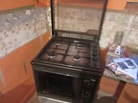 Combination gas hob and microwave oven