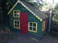 Childrens wooden playhouse, two storey with ladder