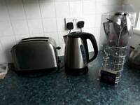 Kettle/ toaster/ cooking utensils and cutlery.
