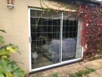 Double sliding doors with leaded lights