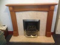 Gas fireplace and marble and wood surround