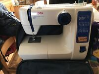 Toyota 'Jeans' sewing machine. Used once perfect condition. Comes with carry case