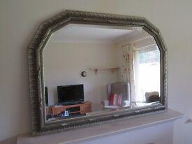 Mantle mirror. Metal effect.