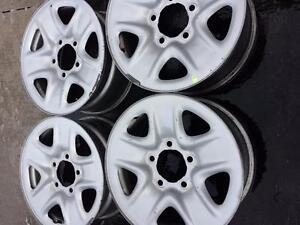 TOYOTA TUNDRA FACTORY OEM 18 INCH STEEL RIM SET OF FOUR.LUG NUTS INCLUDED.