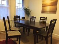 Lovely dark wood dining table and 6 chairs Marrakech Collection