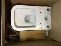 Brand new modern toilet, cistern, soft close seat and flush system