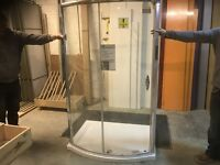 Bow front shower base and glass enclosure, Brand new and never used.