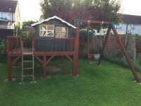 Playhouse with swing