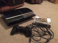 PlayStation 3 and three games and wireless controller