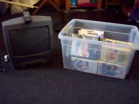 A BOX OF 34 VIDEOS WITH A SMALL PHILLIPS TELEVISION THAT PLAYS VIDEOS