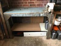 Metal workbench with wood top and a vice