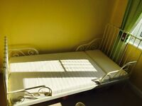 IKEA white extendable bed with mattress