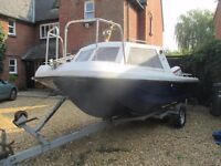 Wilson Flyer fishing boat with 70 horse power outboard and extras