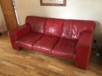 Red Leather Suite. 2 3 seater red leather settees, 1 red leather chair and red leather pouffe.