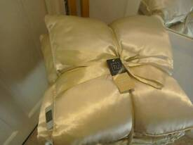 Two cushions and throw